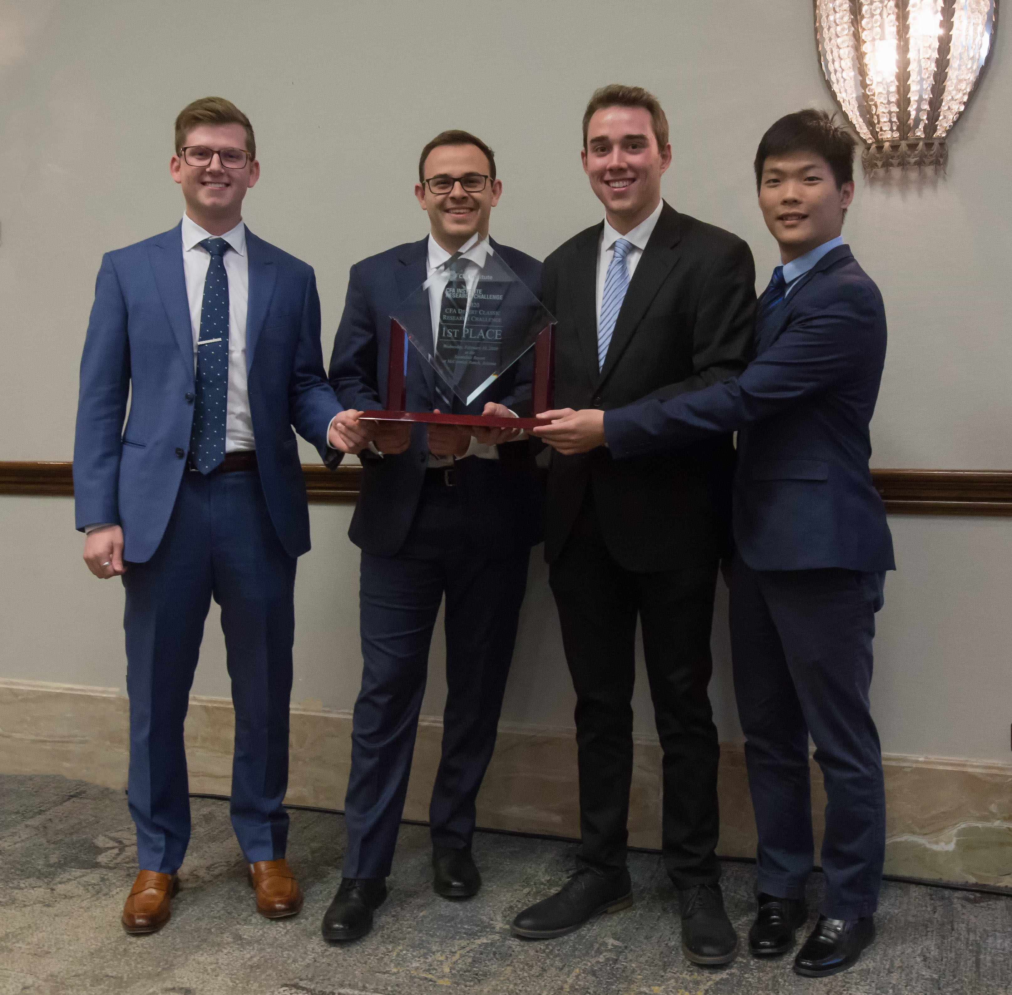 Finance students Payton Rudnick,Steven Feeney,Nick StankovenandJingsong Wu with their first place award
