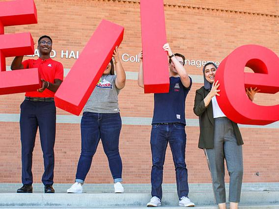 Eller College students with ELLER letters