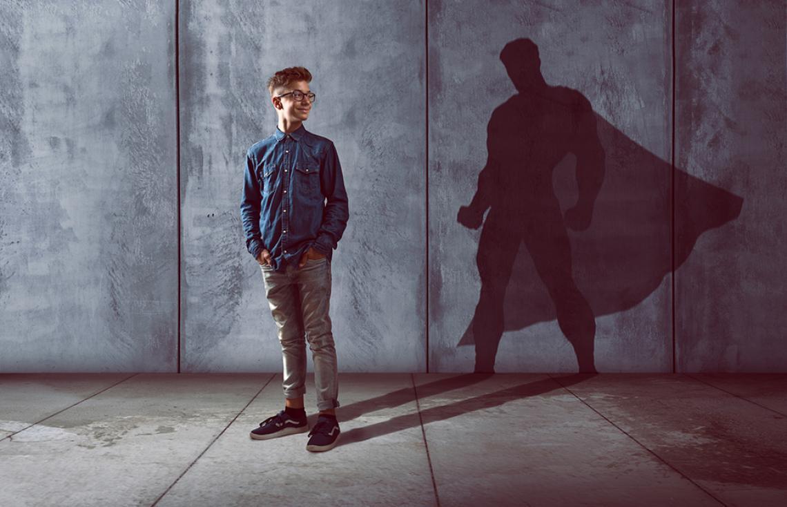 photo of student casting superhero shadow