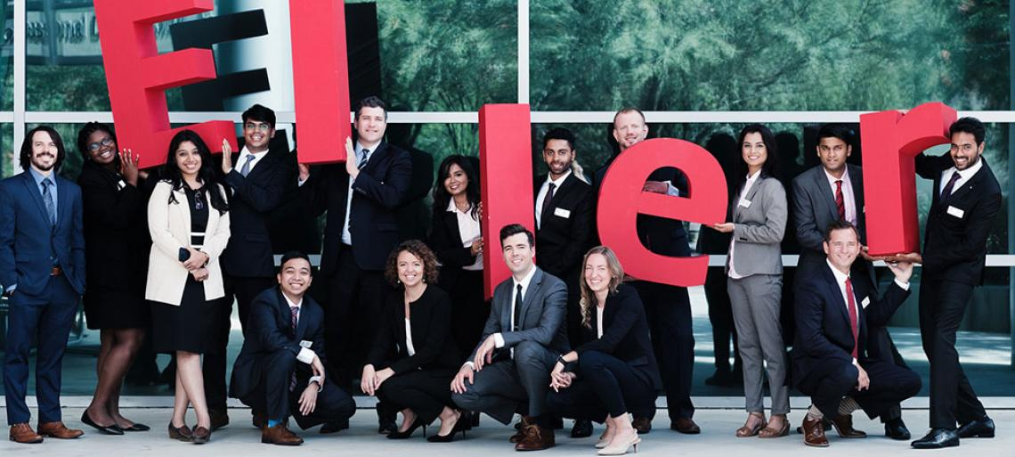 Eller MBA students with ELLER letters