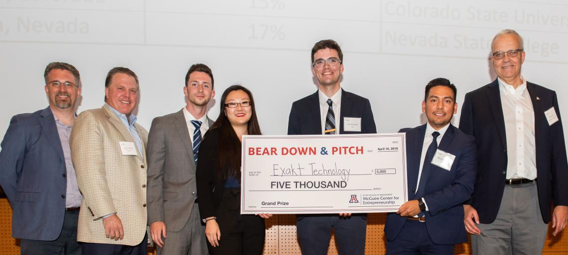 student team with $5000 check