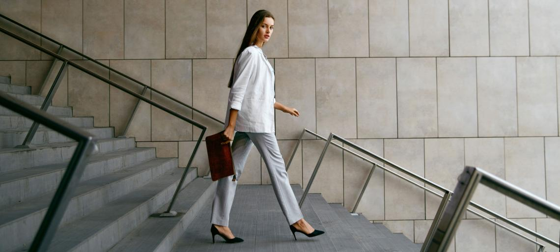 Business woman walking with a purse