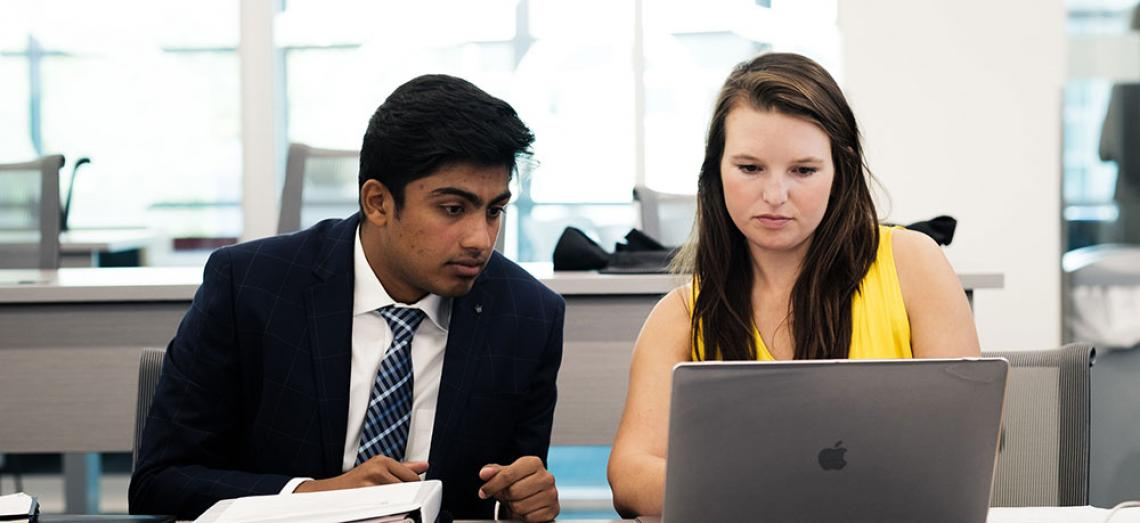 Eller students with laptop