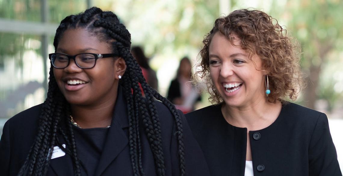 Smiling female MBA students