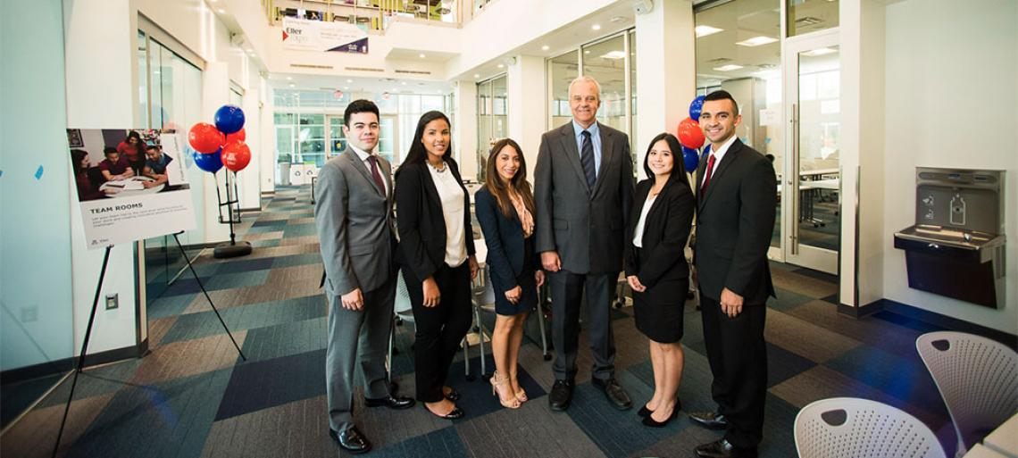 Eller Dean Paulo Goes with students in the new Eller Professional Development Center