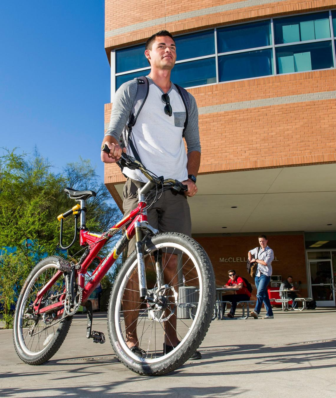 Eller Sports Management student with bicycle